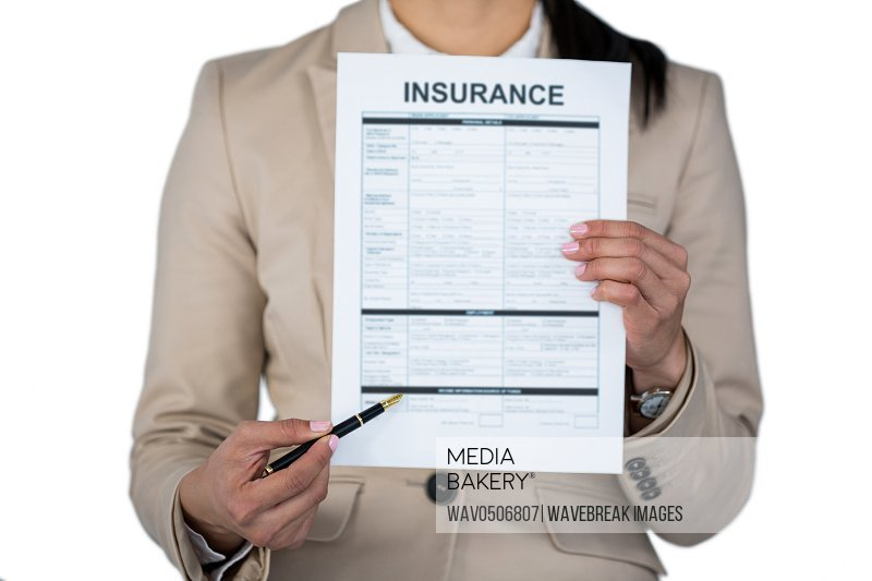 Mid section of businesswoman showing insurance contract against white background