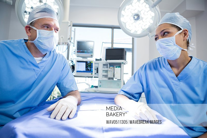 Surgeons interacting with each other in operation theater