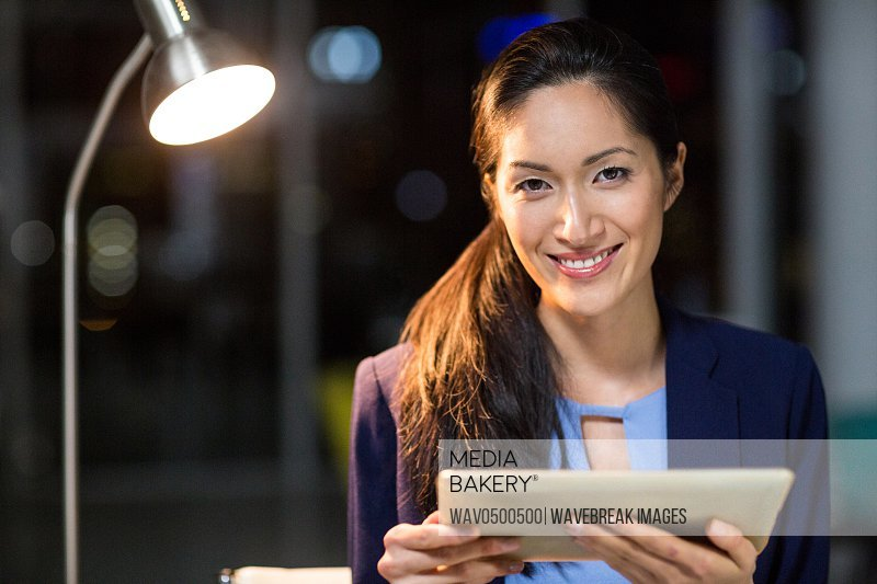 Portrait of businesswoman holding digital tablet in the office