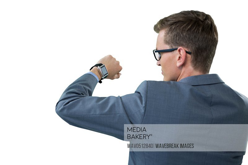 Rear view of businessman checking his smart watch