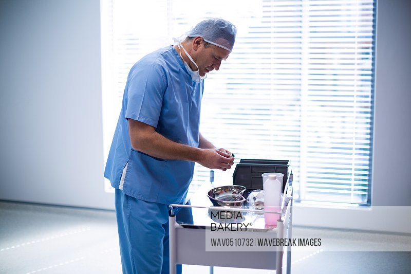 Surgeon holding medical tool at hospital