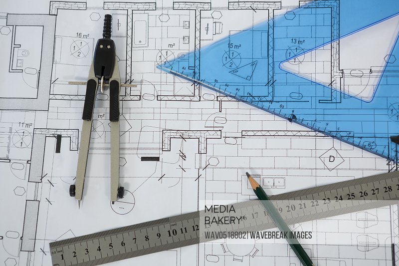 Blueprint with ruler pencil and thumbscrew compasses