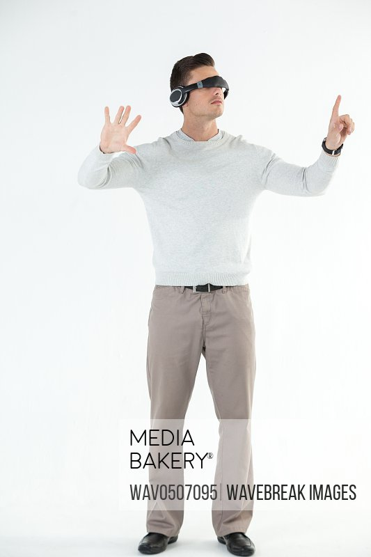 Man using virtual video glasses against white background