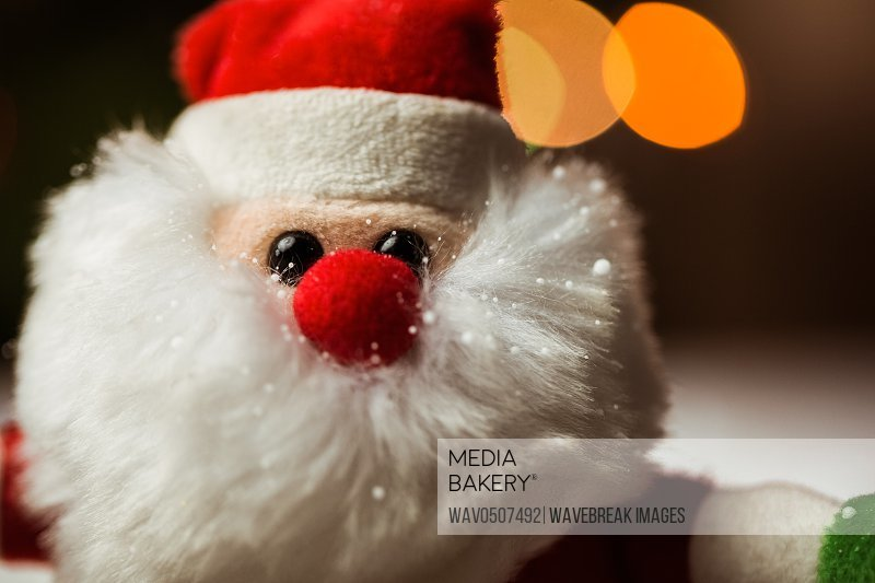 Close-up of santa claus during christmas time