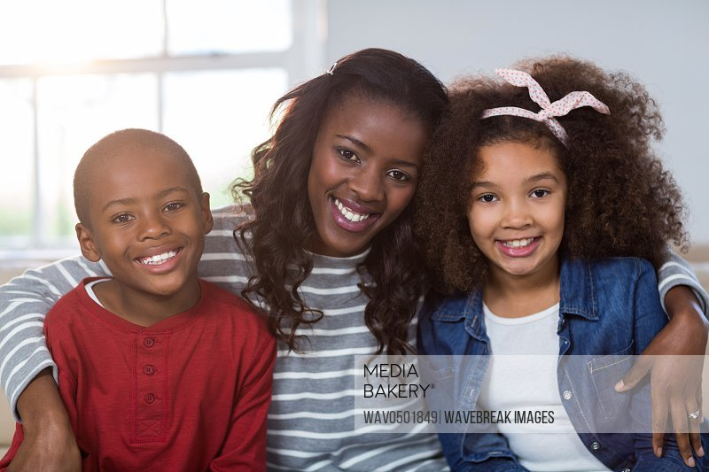 Portrait of mother with their children at home