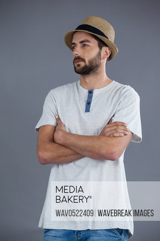 Man in white t-shirt and fedora hat