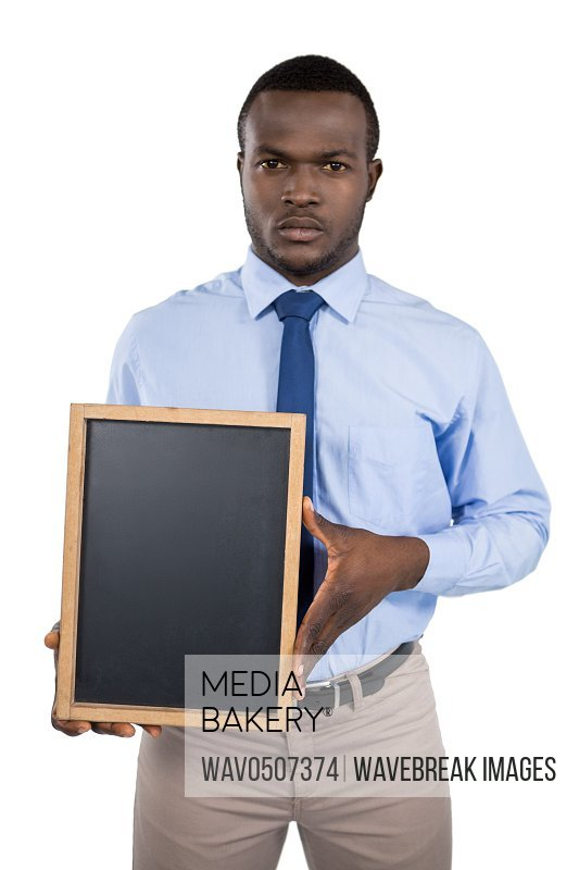 Businessman holding a blank board against white background