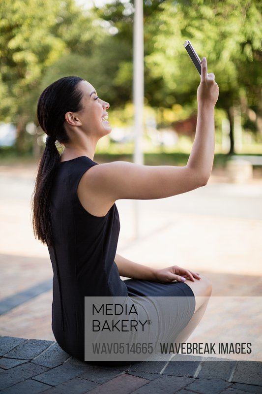 Happy businesswoman taking a selfie on mobile phone