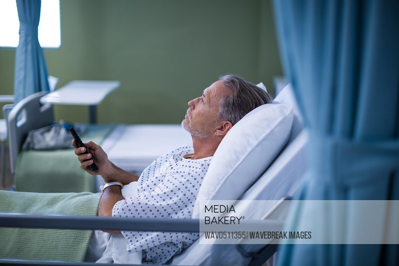 Patient watching television on bed at the hospital