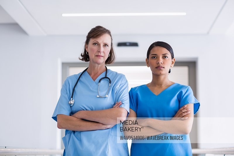 Portrait of nurse and doctor standing with arms crossed