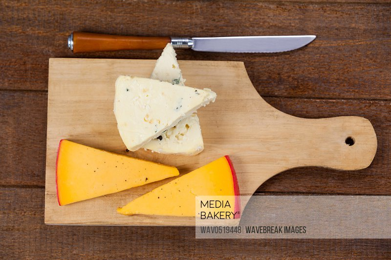Slices of cheese with knife
