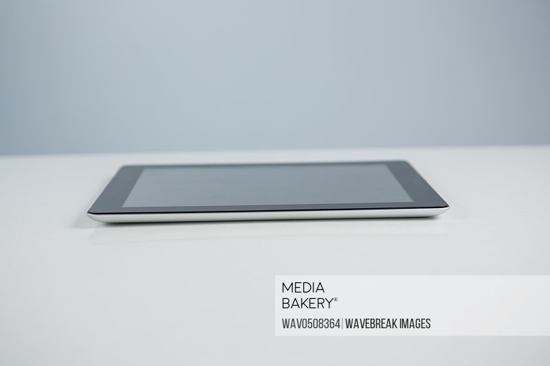 Close-up of digital tablet against white background