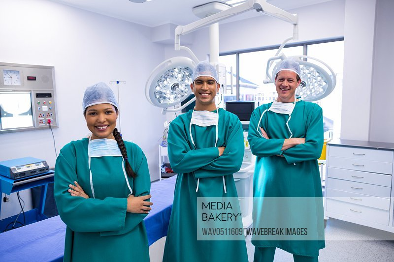 Portrait of surgeons team in operation theater of hospital
