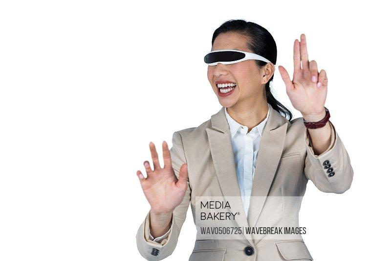 Businesswoman using virtual video glasses against white background