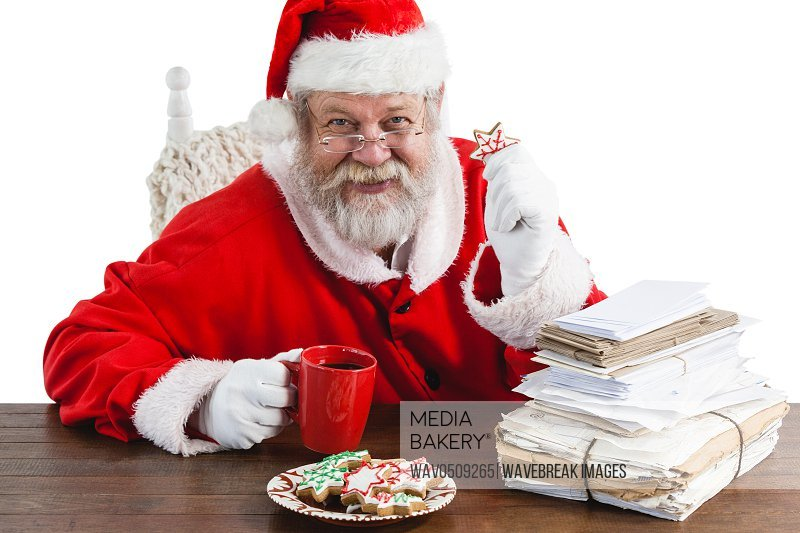 Santa claus having a cup of coffee