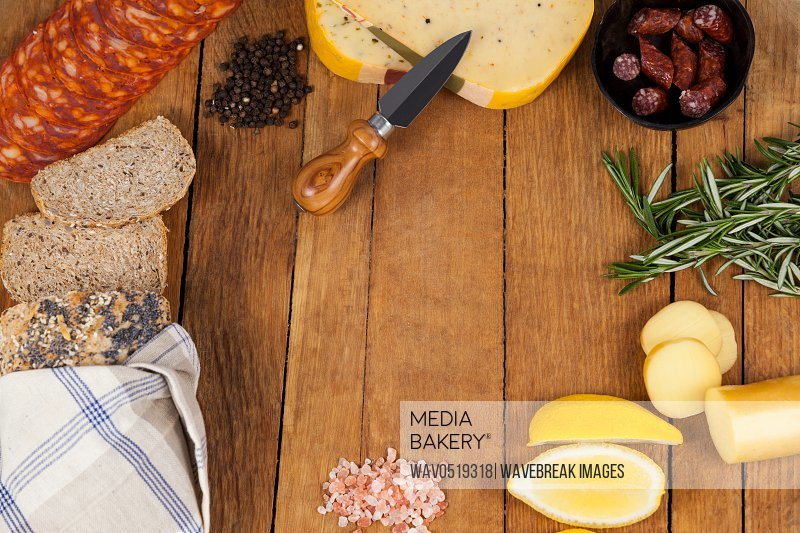 Cheese ham and bread with various ingredients on chopping board