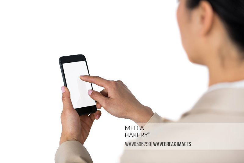 Businesswoman using mobile phone against white background