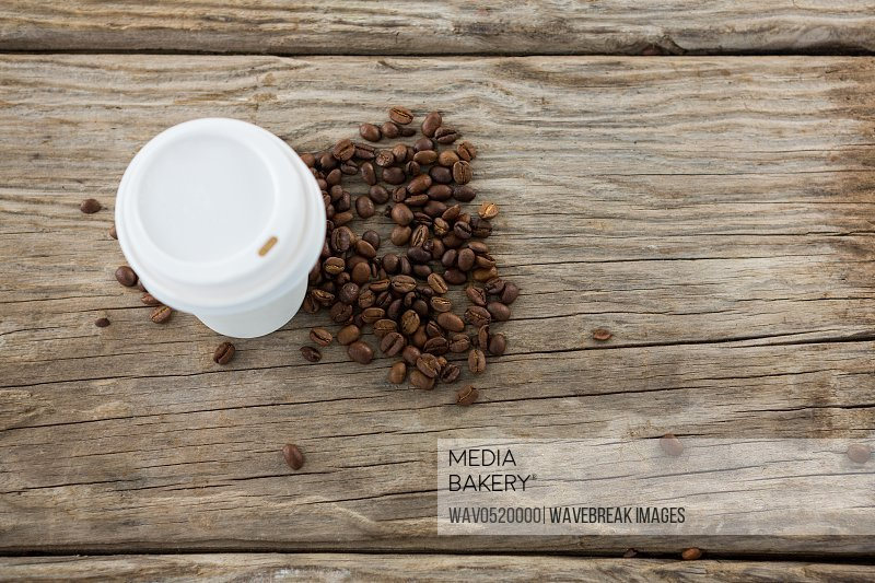 Coffee beans with disposable coffee cup