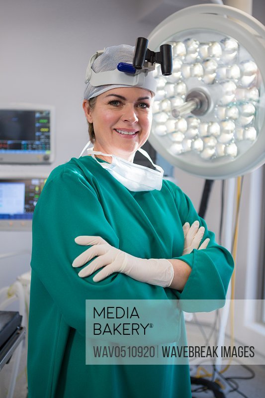 Portrait of female surgeon wearing surgical loupes in operation theater