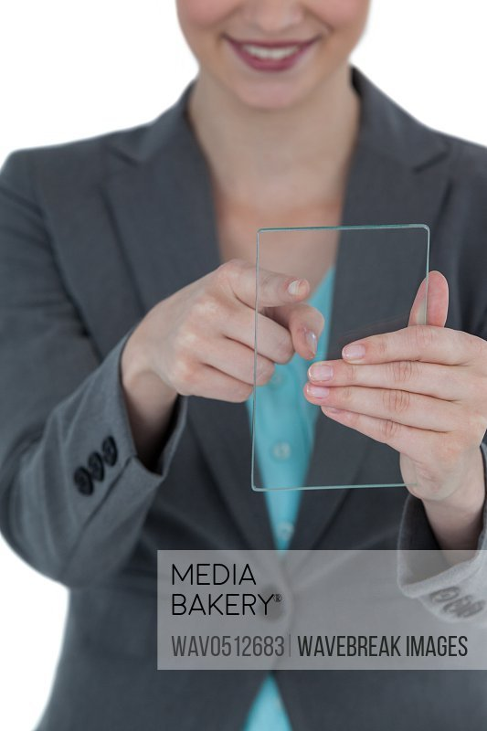 Businesswoman pretending to use mobile phone against white background