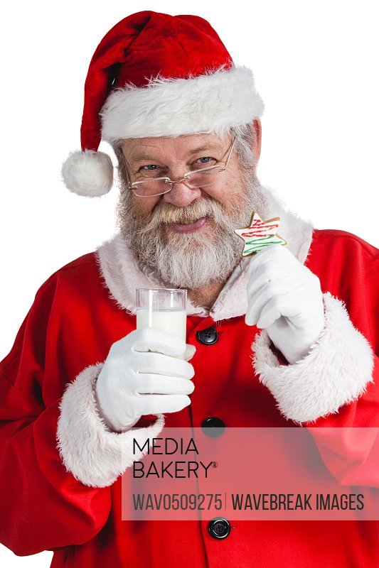 Portrait of santa claus holding glass of milk