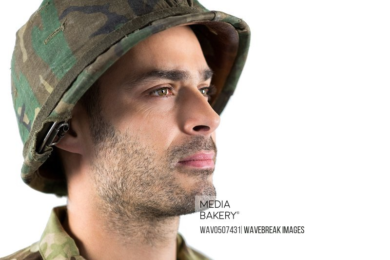 Close-up of confidence soldier against white background
