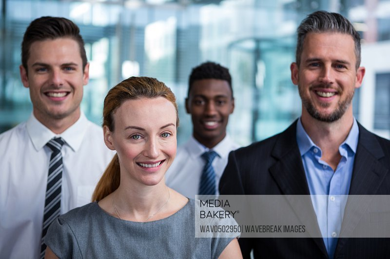 Portrait of happy businesspeople standing in office
