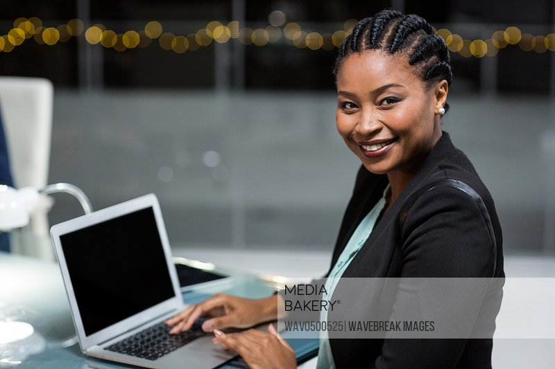 Portrait of businesswoman using laptop in the office