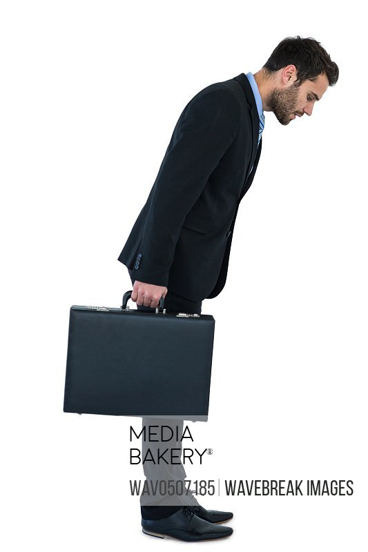 Businessman holding briefcase and looking down on white background