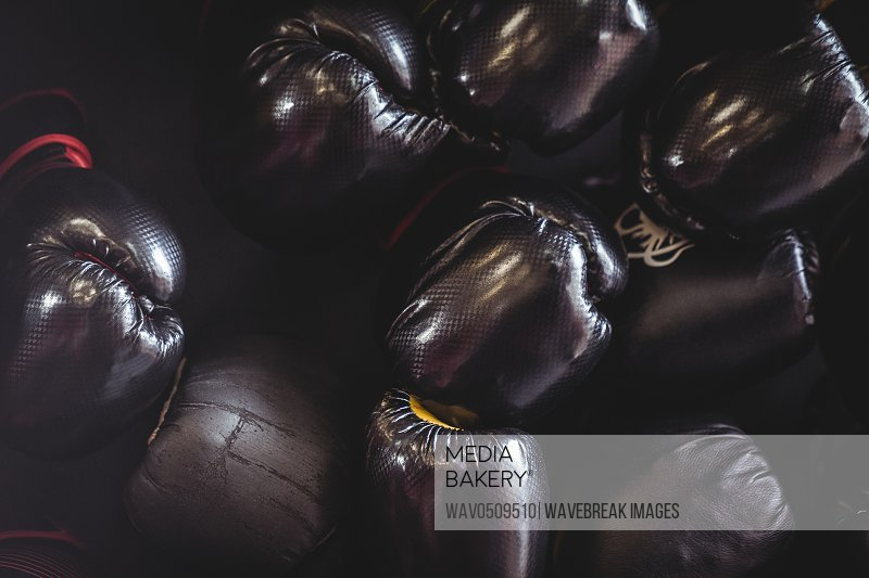 Close-up of black boxing gloves in fitness studio