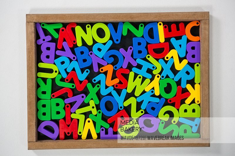 Multicolored Jumbled alphabets on slate board