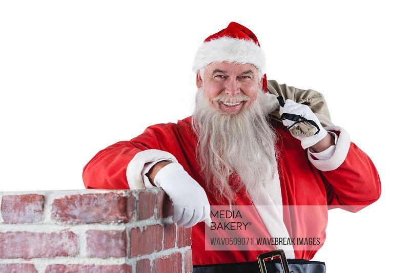 Portrait of santa Claus carrying bag full of gifts