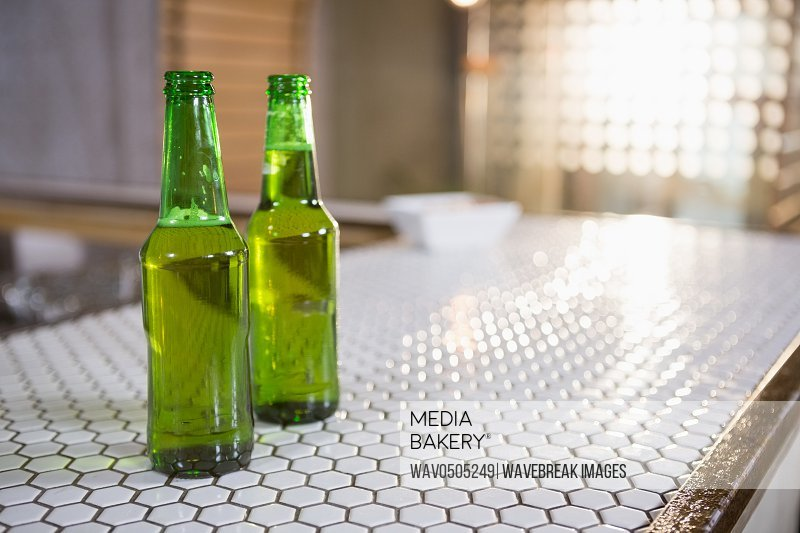 Bottle of beer on bar counter in bar