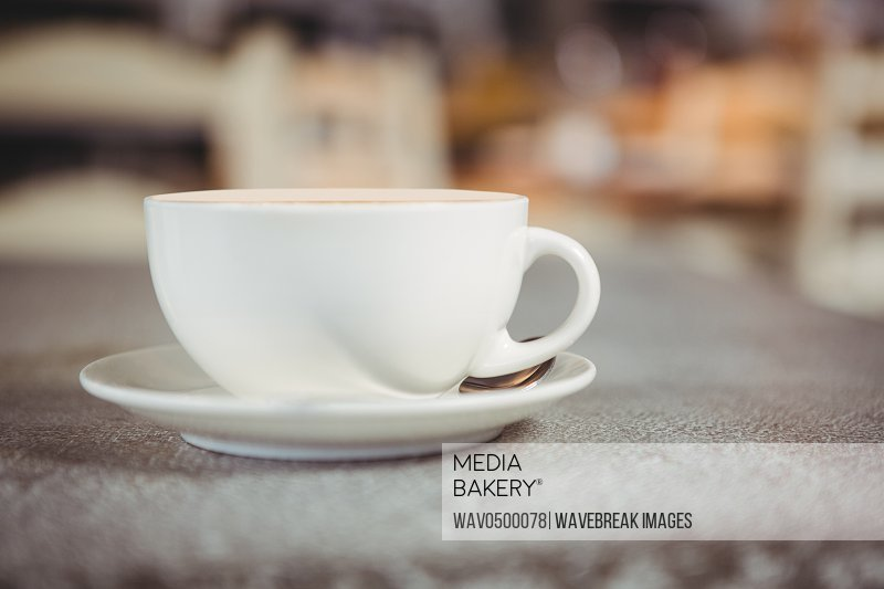 Close-up of coffee cup on a table in cafeteria
