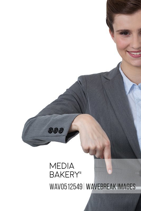 Beautiful businesswoman using digital tablet against white background