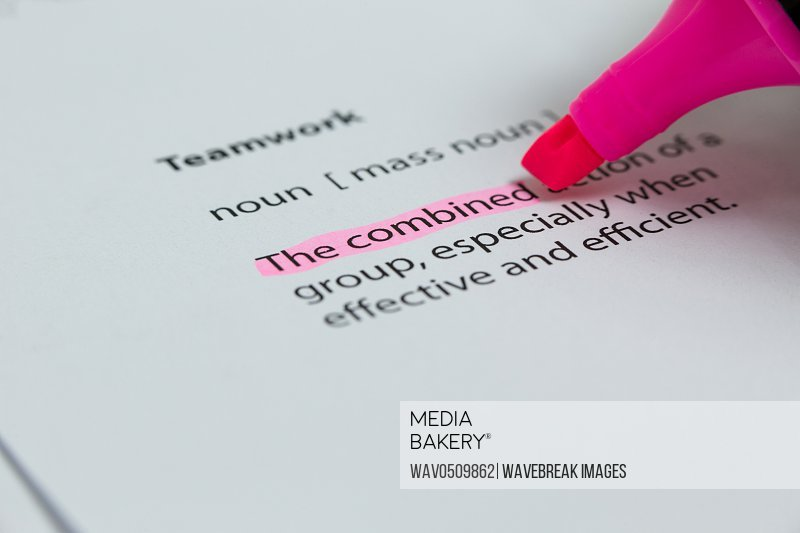 The word combined highlighted in pink with felt tip pen