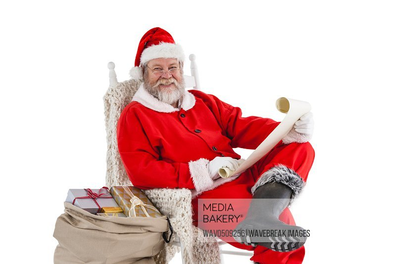 Happy santa claus holding a scroll