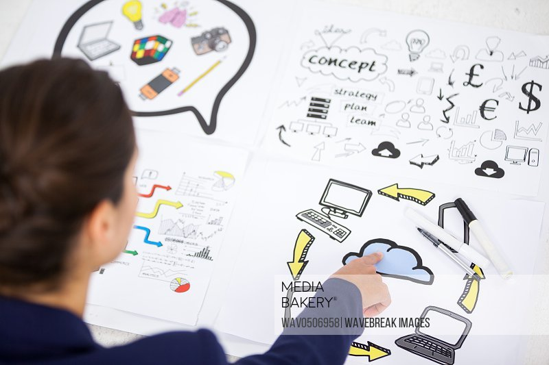 Businesswoman working on icon charts against white background