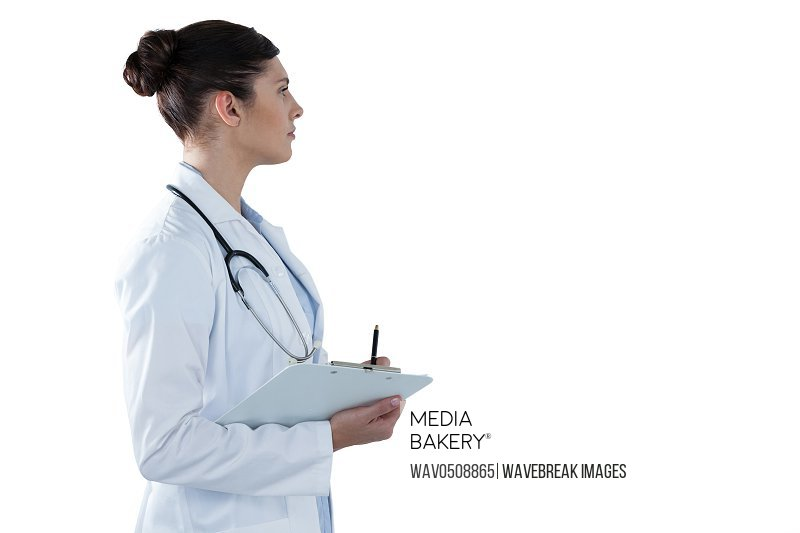 Female doctor holding clipboard and looking away