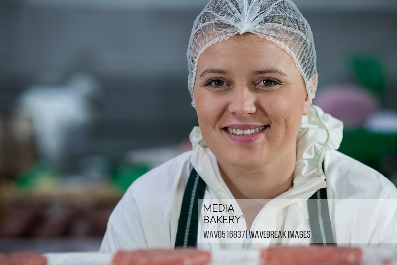 Female butcher at meat factory