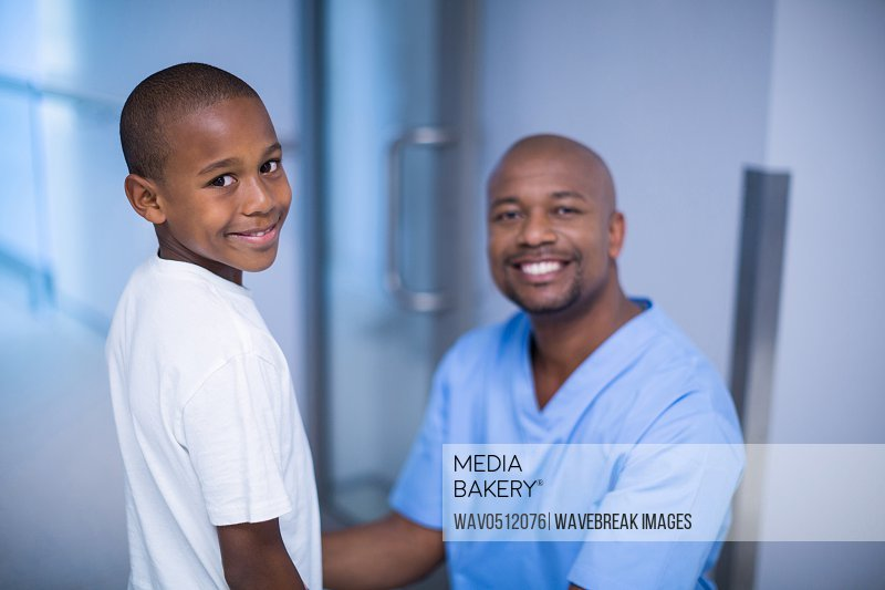 Portrait of smiling doctor and patient in hospital