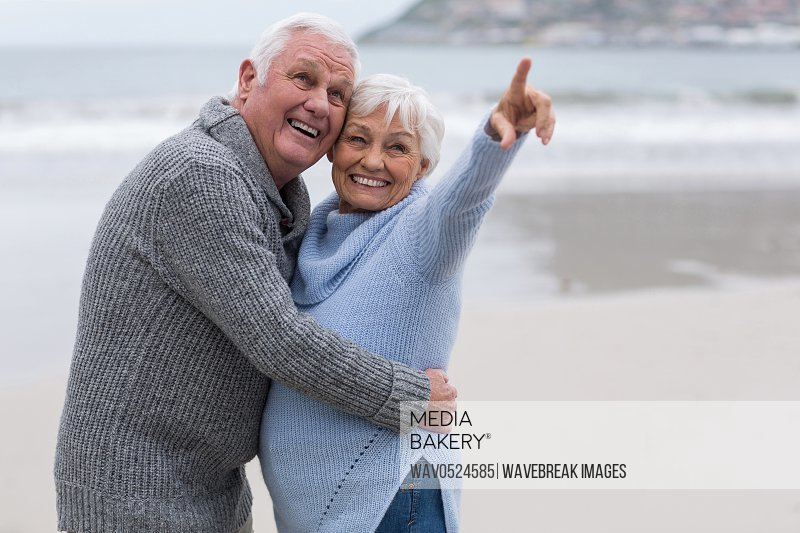 Senior couple standing together on the beach