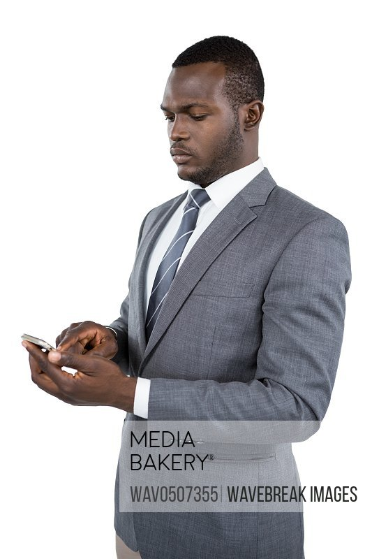Businessman using his mobile phone against white background