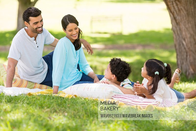 Happy family enjoying together in a park