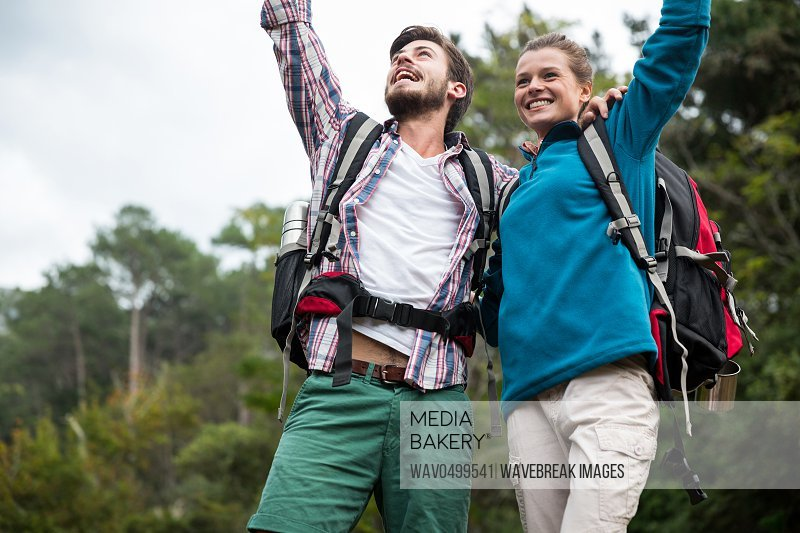 Excited hiker couple in forest at countryside