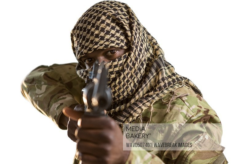 Portrait of soldier aiming with a rifle against white background