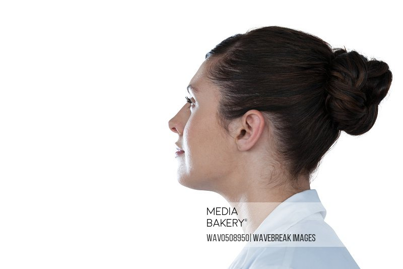 Side view of thoughtful female scientist looking away