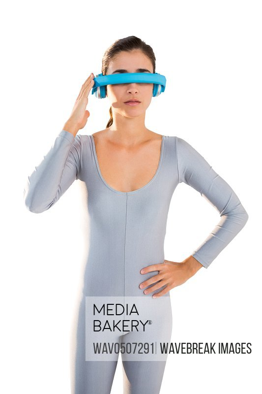 Woman in exercise outfit using virtual video glasses against white background