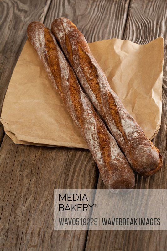 Baguettes on wooden background