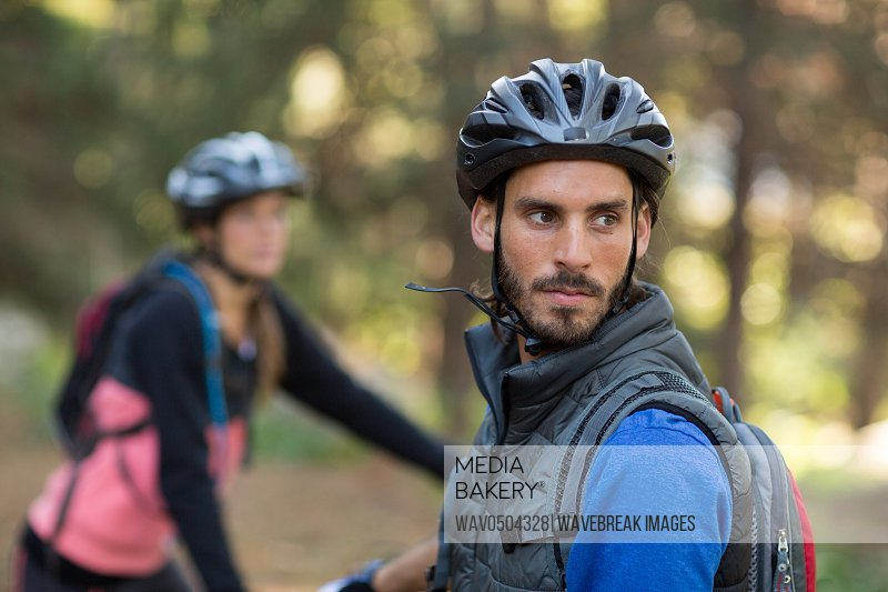 Male biker in countryside forest